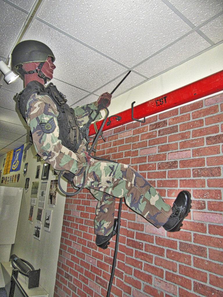 EST member descending wall