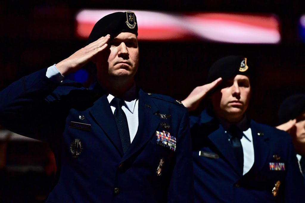 AF member in blues saluting